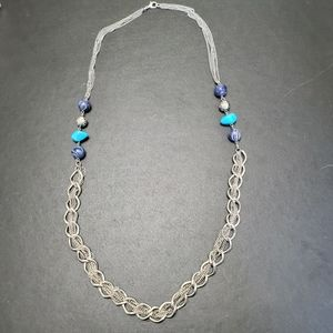 Silver tone necklace with blue beads